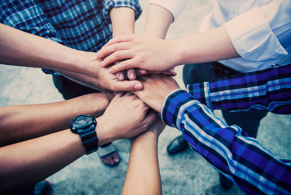 Business teamwork join hands together outdoor man.