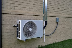 Air,Conditioner,Mini,Split,System,Mounted,On,Brick,Wall,With
